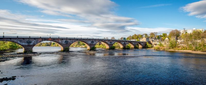 Scenic arched West Bridge across River Tay in Perth city, Scotland