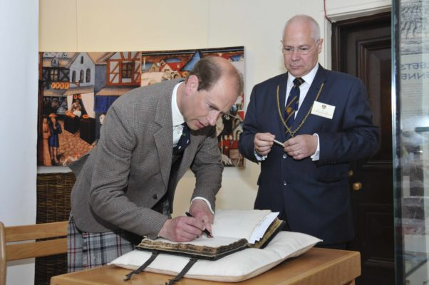 Prince Edward signing the Lockit Book during his visit to Perth Museum